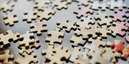 Puzzle pieces scattered on a table. These symbolically represent structured products.